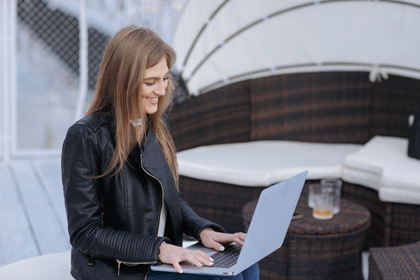 Woman on laptop typing for Blue Sky Chat
